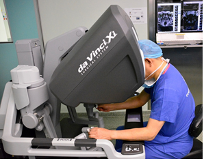 Dr Chin doing surgery on latest Xi robot
